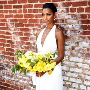 Lemonade Yellow Bouquet with Bride in White Jumpsuit