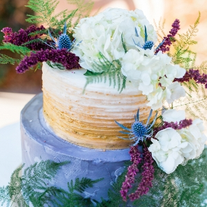 A Wild Winter Cake with Greenery and Flowers