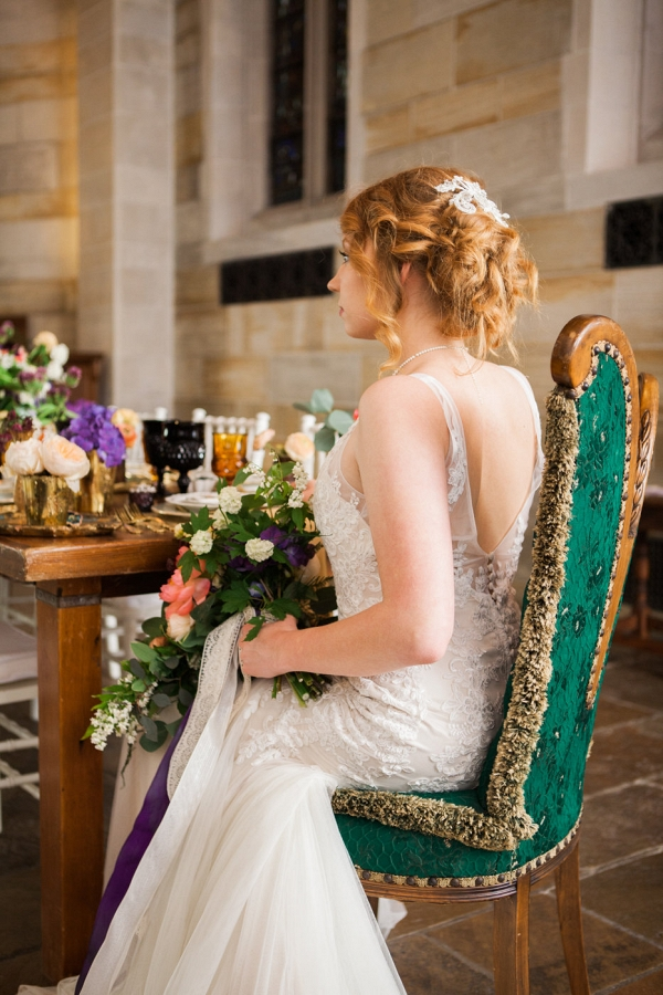 Bride Seated at Victorian Styled Table in Chapel