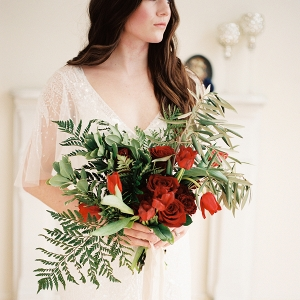 Bride with Bouquet of Red Roses and Tulips