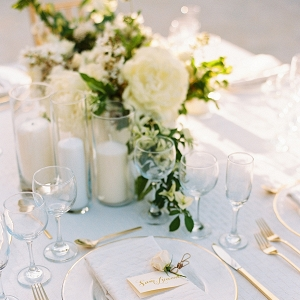 All White Place Setting With Flowers and Candles