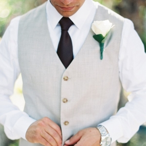 Groom Wearing Vest and Tie