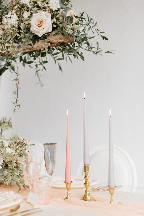 tablescape with silk runner, taper candles and pretty glassware