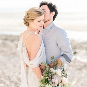 engagement session portrait of couple with floral bouquet