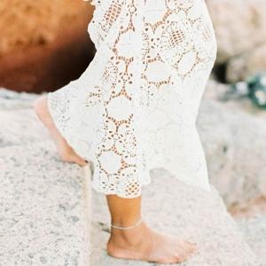 Barefoot Bohemian bridal portraits on a rocky beach
