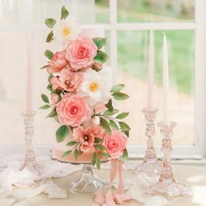 wedding cake decorated with elaborate sugar flowers