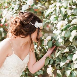 bridal portrait amongst the camellia flowers