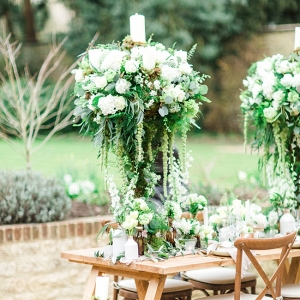 Organic Tablescape with Tall Centrepieces with Trailing Foliage and White Roses