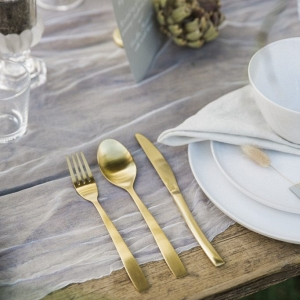 table setting and gold cutlery