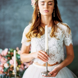 bridal portrait holding a tall tapered candlestick