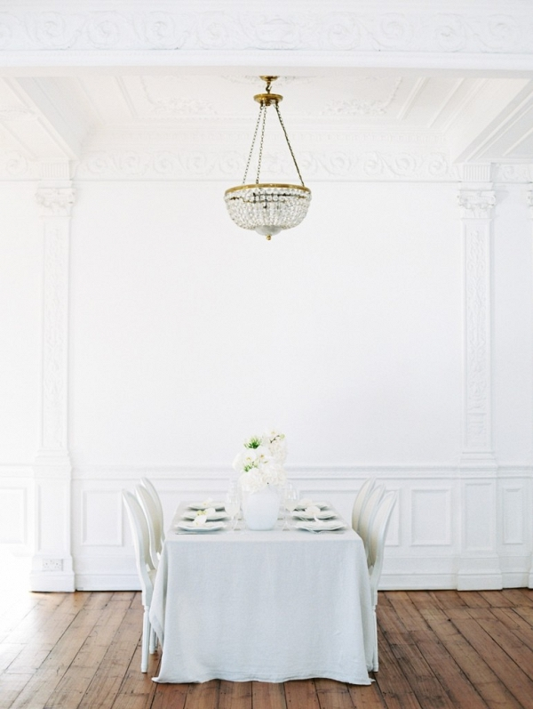 white ballroom with wedding table setting