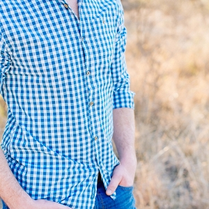 shirt and jeans details of oliver's engagement session outfit