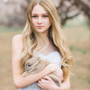 Bridal portrait ideas with blossom trees and bunny rabbits