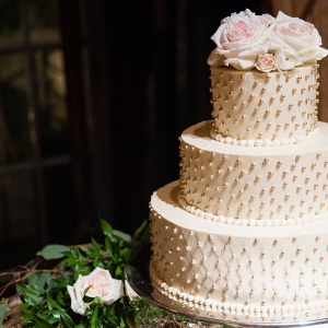 A Three Tiered Buttercream Wedding Cake is Adorned with Gold Beads at This Classic Emerald Winter Pittsburgh Wedding