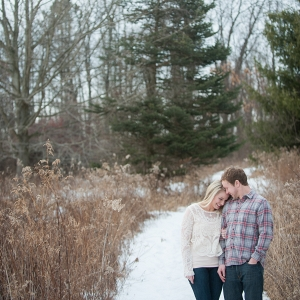 This Pair Looks Comfy and Cozy During Their Snowy Field Engagement Session