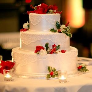 Three Tier Buttercream Wedding Cake Holly Votive Candles Sparkly Christmas Wedding