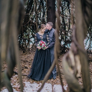 Twisted Dead Trees, Snow, and a Black Lace Dress were the Perfect Details for this Twisted Fairy Tale Engagement Session
