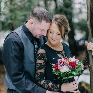 A Pop of Color from a Bouquet of Fresh Flowers was Bright against a Black Dress in this Twisted Fairy Tale Engagement Session