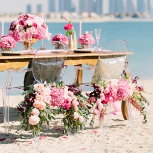 Luxurious hot pink and gold Dubai beach wedding