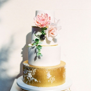 Blush and gold wedding cake on Burnett's Boards