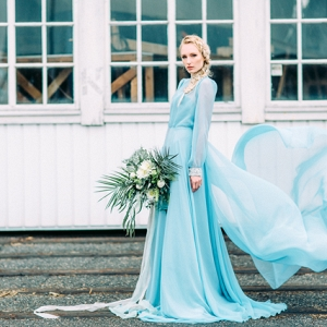 Bride in blue wedding dress on Burnett's Boards