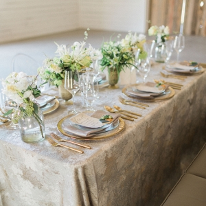 An elegant and rustic modern tablescape with a pewter and gold color palette.