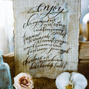 Calligraphy wedding menu on linen