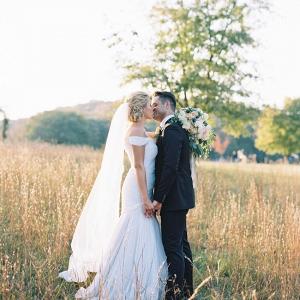 The Bride & Groom's Romantic Kiss in Golden Sunlight