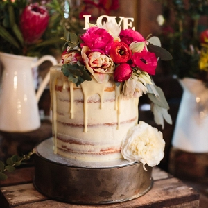 Drizzle Floral Topped Wedding Cake