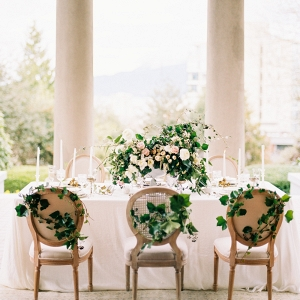 elegant greenery covered table on Elizabeth Anne Designs