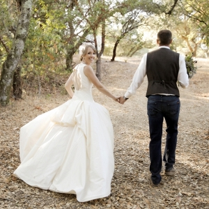 bride and groom walking photo