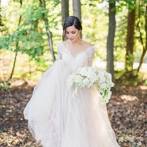 Bride in long sleeve lace gown on Every Last Detail