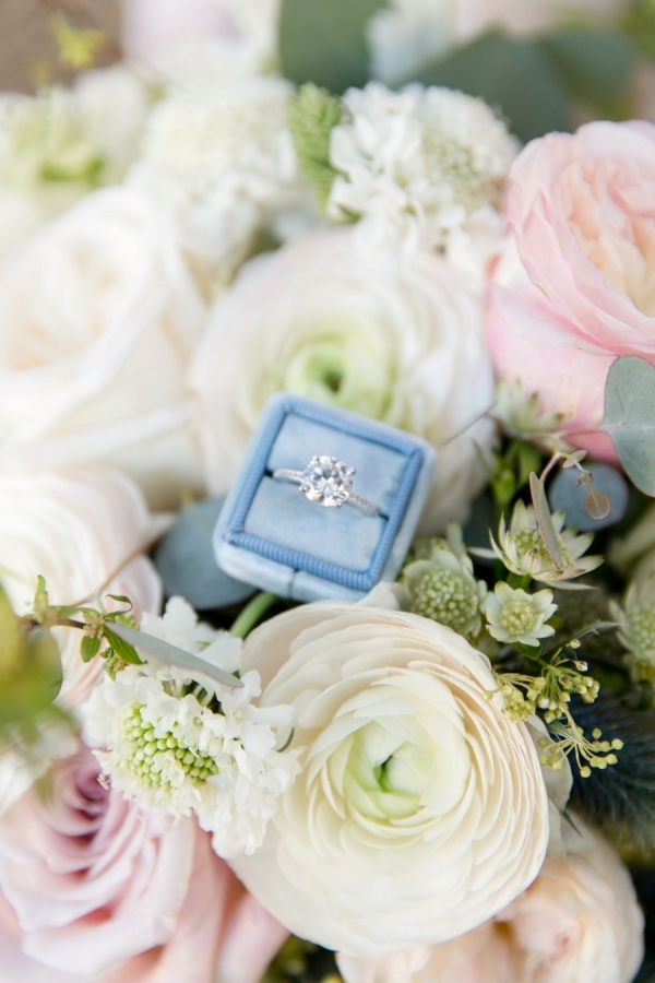 Blue ring box with a solitaire diamond ring