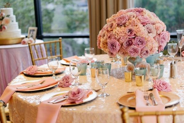 Blush centerpiece on a champagne sequin linen