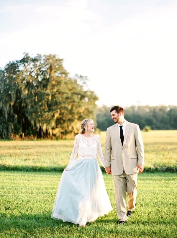 Bride in a pale blue tulle skirt and groom in a tan suit