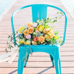 Turquoise Metal Chairs with Yellow Bouquet