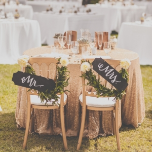 Reception chairs with Mr. & Mrs. signs