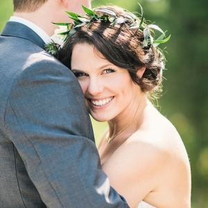 Happy bride hugging groom