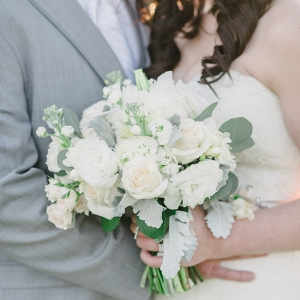 Bride And Groom With White Bouquet