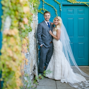 Beautiful Bride & Groom in Front of Turquoise Door