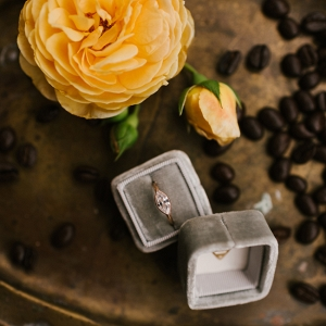 Engagement Ring Surrounded By Coffee Beans