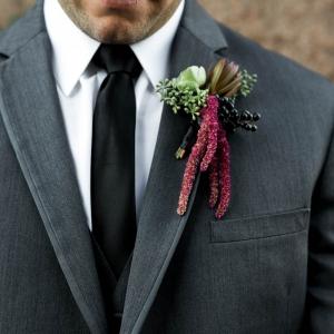 Handsome groom in gray suit