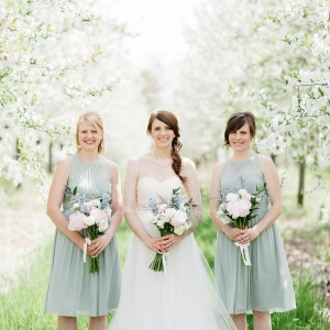 Bride and bridesmaids in cherry tree orchard
