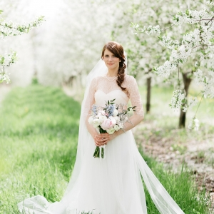 Bride in cherry tree orchard