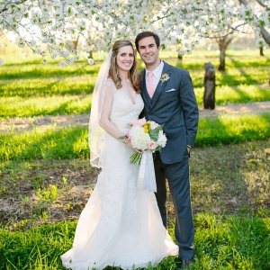 Bride And Groom In Cherry Tree Orchard