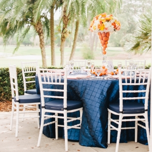 Orange, Navy Blue, and white citrus wedding tables