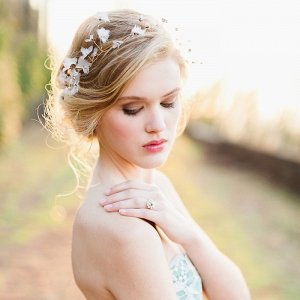 Graceful Bridal Updo with a Delicate Halo Headpiece