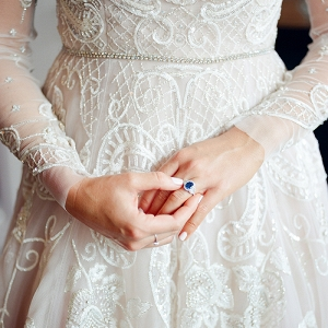 Crystal embroidered lavender wedding dress with a sapphire ring for a colorful gemstone inspired wedding