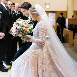 Glamorous Church Wedding Ceremony with a Princess Wedding Dress and a Cathedral Veil
