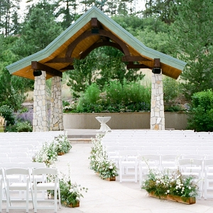 Elegant Mountain Wedding Ceremony with Wildflower Aisle Decor